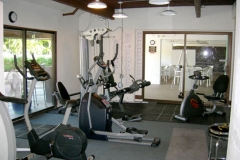 Exercise room in the pool area with A/C